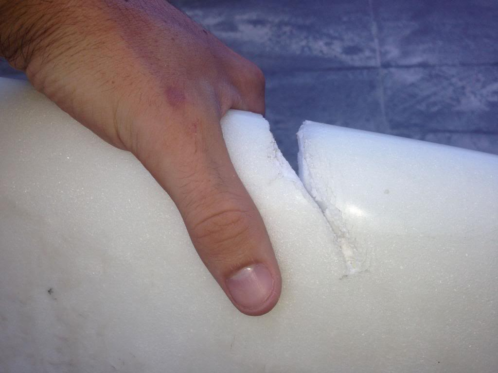Cracked secondhand surfboard