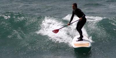 escola catalana de surf clases de paddle surf en olas